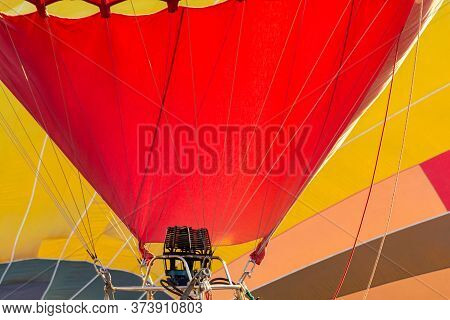 Balloon Flying High In The Sky. Aerostat Close-up. Aeronautic Sport. Burning Gas. Bright Multi-color