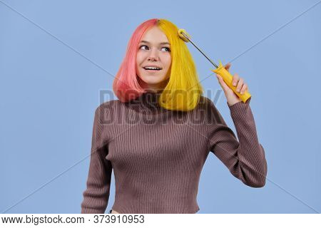 Beautiful Girl Dyes Her Hair With Construction Roller, Teenager With Fashionable Colored Yellow Pink