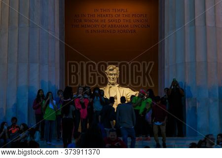 Spring, 2016 - Washington Dc, Usa - An Illuminated Lincoln Statue At The Lincoln Memorial. Tourists
