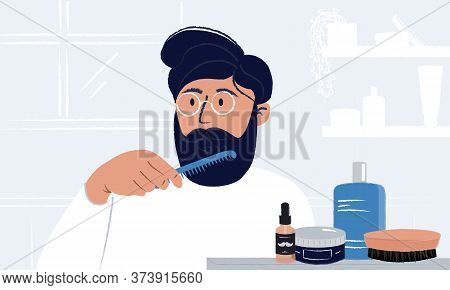 Young Man Wearing Glasses Brushing His Beard And Looking In The Mirror Having Styling Cosmetic, Brus