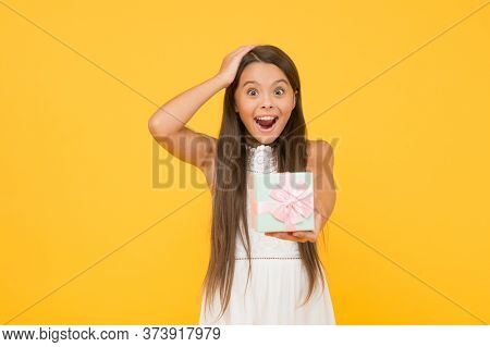 Extremely Impressive. Perfect Package. Child Happy Face Holds Big Gift Box Yellow Background. Kid Gi