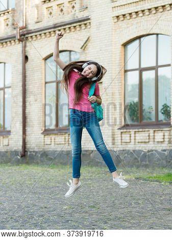 Active School. Active Child Jump To Music. Happy Girl Back To School. Active Childhood. School Time.