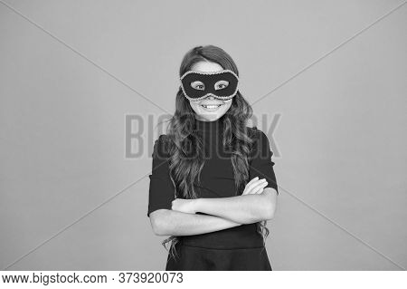 Mysterious Guest. Girl Wear Mask Orange Background. Event And Entertainment. Party Celebration. Visi