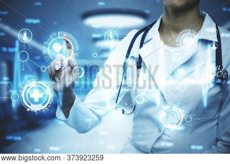 Doctor With Stethoscope Using Glowing Medical Icons Interface. Medicine And Innovation Concept. Doub