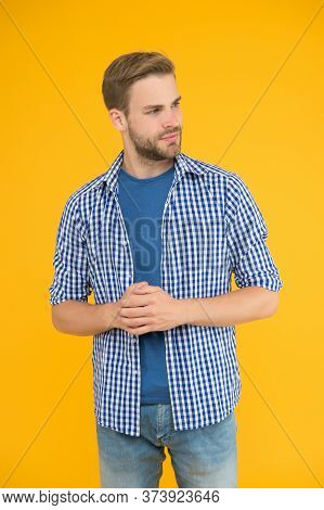 Clothes For Daily Life. Handsome Man Unshaven Face And Stylish Hair. Caucasian Man Yellow Background