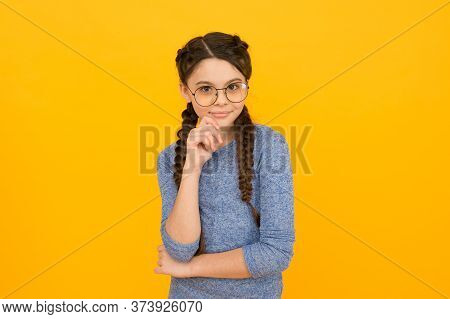 Cute Schoolgirl. Eyeglasses For Eyes Health. Girl School Pupil Wear Eyeglasses Yellow Background. Ad