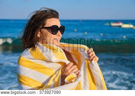 Happy Mature Woman Relaxing On The Beach, Smiling Female In Sunglasses With Towel On Shoulders, Copy