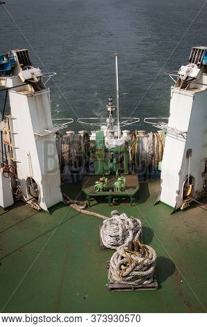 Mooring Winch Of Large Ship With White Rope In Drum.