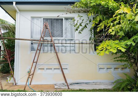 Trestles Set Up To Paint Exterior Of A House