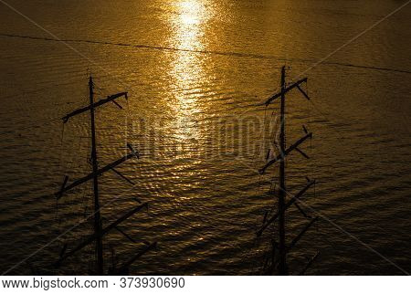 Ships Riggings And Masts In The Sunset.
