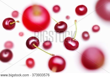 Flying Cherry. Several Berries Of Falling Cherry With Shallow Depth Of Field Isolated On A White Bac