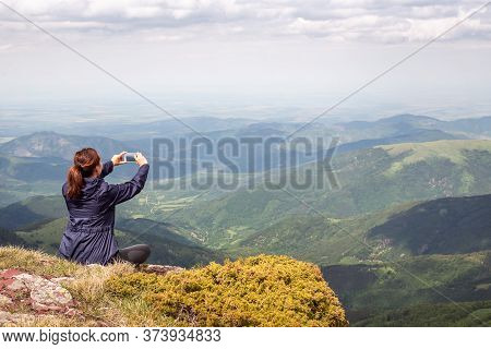 Traveling In Nature, Woman Photographing Landscape. Traveling In Nature. Woman Travel Outdoor In Nat