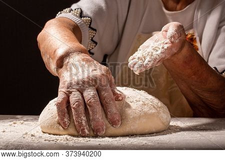 Photo Of Flour And Women Hands With Flour Splash. Cooking Bread. Kneading The Dough