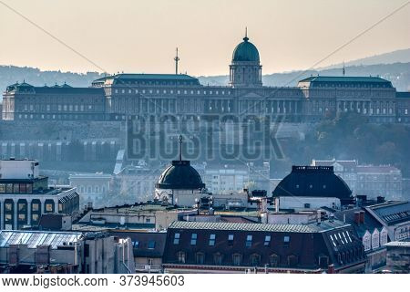 Beautiful cityscape view of Buda Castle and palace of the Hungarian kings in Budapest, Hungary in the morning fog.