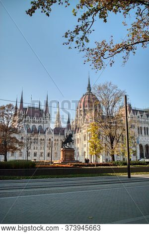 Beautiful cityscape of monument Rakoczi Ferenc equestrian statue on the background of Hungarian paliament building, Budapest, Hungary.