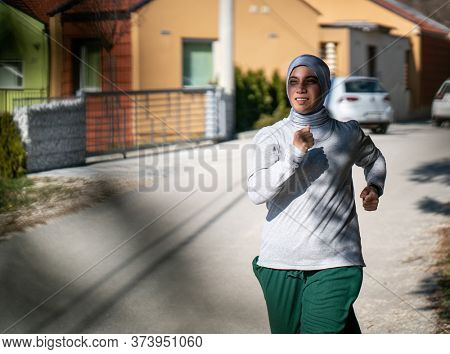 Middle Eastern Woman Exercising in Nature Running