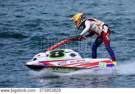 Wyboston, Bedfordshire, England -  May  12, 2019: Young Jet Ski Race Competitor Moving  At Speed.