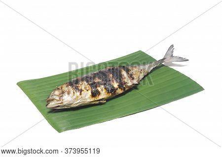 Grilled Fish On Banana Leaves On White Background. (with Clipping Path).