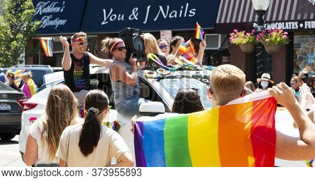 Babylon, New York, Usa - 28 June 2020: Decorated In Rainbow Colors Spectators Watch Cars Driving Up