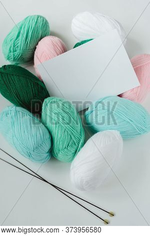 White Paper Sheet On Knitting Acrylic Soft Pastel Colored Wool Yarn Thread Skeins Heap And Needles O