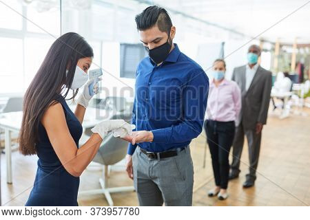 Disinfect hands of business people in front of the office as a precaution against Covid-19 and Coronavirus