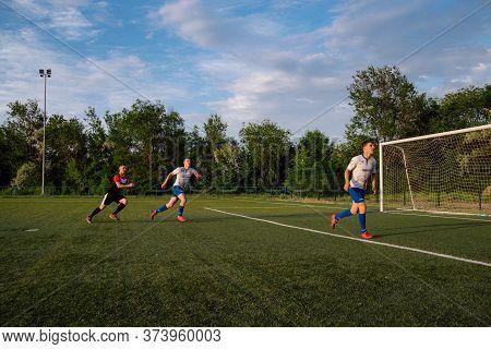 Soccer Player Kicks The Ball.soccer Player Takes A Corner Kick.football Player Kicks The Ball On The