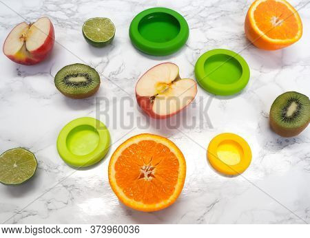 Variety Of Cut Fruits And Colorful Reusable Silicone Food Wraps For Reducing Food Waste In A Zero Wa