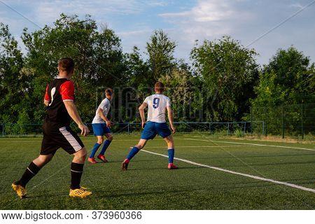 Soccer Player Kicks The Ball.soccer Player Takes A Corner Kick