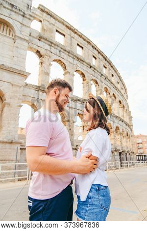Happy Beautiful Couple In Front Of Coliseum In Pula Croatia