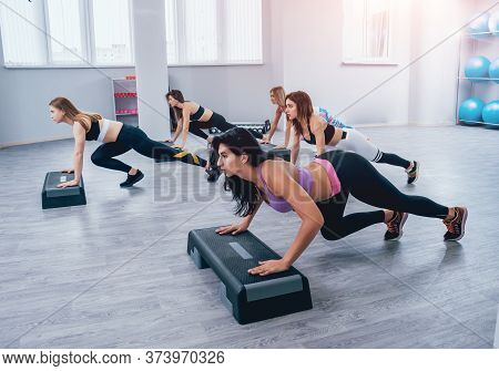 Young Fitness Women Using Step Platform At The Gym. Crossfit Training.