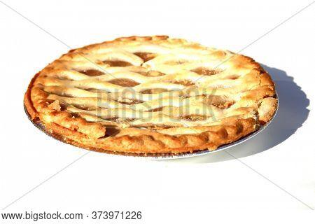 Apple Pie. Fresh Baked Apple Pie. Isolated on white. Lattice top Apple Pie. Whole Fresh  Baked Pie in an Aluminum pan.