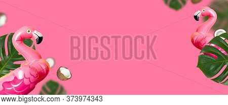 Creative Summer Background. Flying Inflatable Pink Mini Flamingo Tropical Leaf Monstera Coconut On P