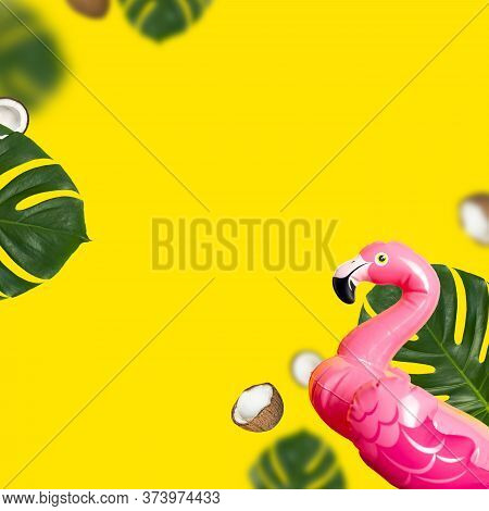 Creative Summer Background. Flying Inflatable Pink Mini Flamingo Tropical Leaf Monstera Coconut On Y