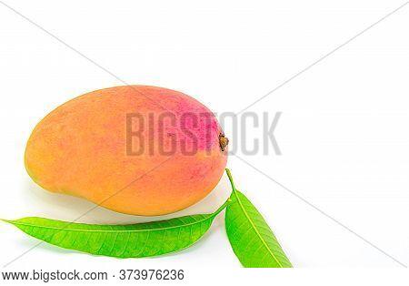 Ripe Mango With Green Leaf On White Background.