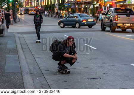 Vancouver, British Columbia / Canada - 06/13/2015. The Hustle And Bustle Of Downtown Vancouver