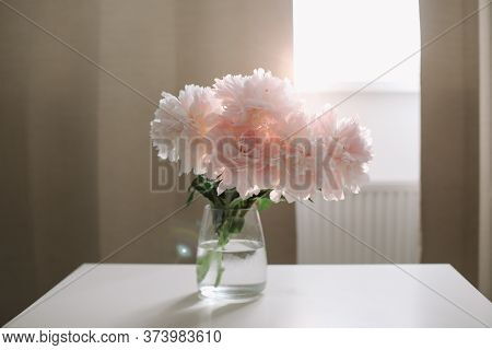 Beautiful Pink Peonies In A Vase At Home Interior. Flower Composition. Floral Shop Concept. Beautifu