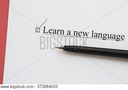 A Piece Of Paper With The Inscription Learn A New Language From To Do List With A Tick