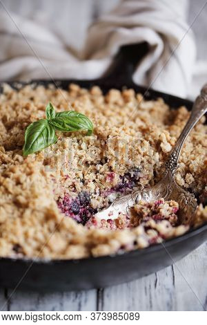 Sweet Homemade Blackberry And Blueberry Basil Cobbler Baked In A Cast Iron Pan And Topped With A Gol