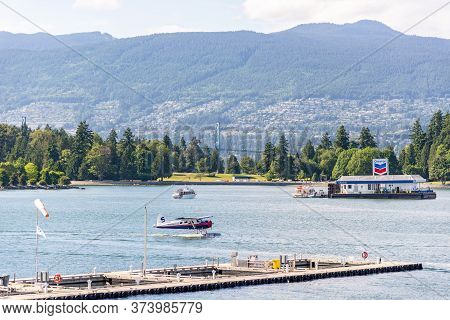 Vancouver, British Columbia / Canada - 06/13/2015. Sea Planes And Boats Sharing The Water In Vancouv