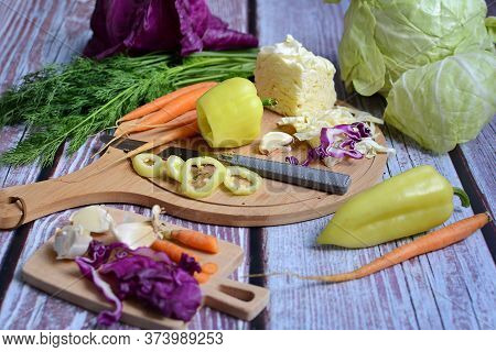 Cooking And Slicing Fresh Vegetables On A Rustic Kitchen Worktop. Healthy Diet Concept. Flat Lay