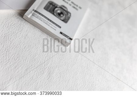 Instruction Book On The Camera. Instruction Manul Book Isolated On White Background