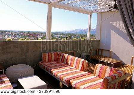 June 22, 2020 In Palm Springs, Ca:  Contemporary Style Patio Furniture Besides A Ledge With A Manicu