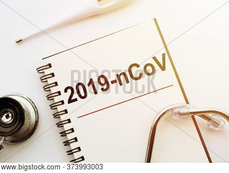 Inscription 2019-ncov In Notebook Thermometre And Stethoscope. Novel Coronavirus Outbreak. 2019-ncov