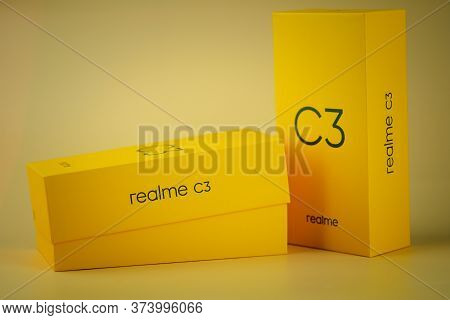 Samut Prakan, Thailand - June 29, 2020 : Yellow Box Of Realme C3 Entry-level Android Smartphone On Y