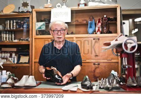 shoemaker craftsman works in his workshop