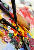 Art palette and brushes with a lot of colors poster