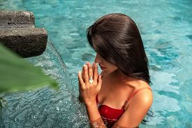 Beautiful Girl On Vacation. Fashion Photo Of A Beautiful Girl In The Pool With Decorations. Beautifu