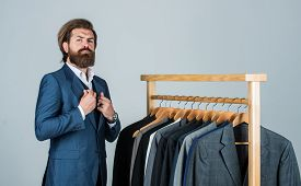 Client At The Studio. Tailor In His Workshop. Handsome Bearded Fashion Man In Classical Costume Suit