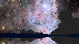 Nebula Reflection Mirror On Dark Night Sky Over Water Surface