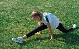 Fitness, Sport, Training, People And Exercising Concept - Teenage Girl Doing Splits. Outdoor Workout